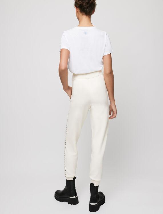 Ecru knit jogging pants with eyelets - Trousers & Jeans - MAJE